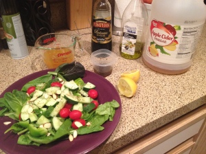 Massive spinach salad with homemade dressing, lemon, olive oil, balsamic vinegar, and apple cider vinegar. Also a cup of organic vegetable stock
